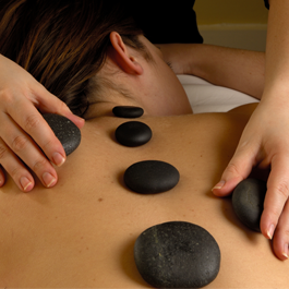 Woman with Hot Stones on Her Back