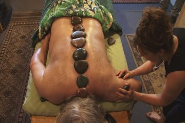 Ana Giving Hot Stone Treatment